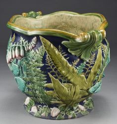 """Minton Majolica Jardinier decorated in foxgloves, ferns and convolvulus on a cobalt background with a mottled green and blue on beige interior, impressed, """"Mintons"""" with cipher for 1888. 13""""H x 19.5""""W"""
