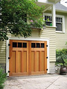Custom side folding garage doors contemporary garage doors for Arts and crafts garage