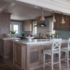 The backsplash makes a understated statement dreamy for Brown and blue kitchen ideas