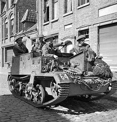Belgium - Infantrymen of the Toronto Scottish Regiment in their Universal Carrier waiting to move forward. Canadian Soldiers, Canadian Army, Canadian History, British Army, British Tanks, Army Vehicles, Armored Vehicles, Ww2 Pictures, Ww2 Photos