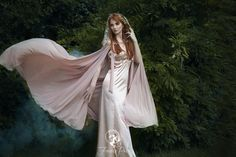 If you want to feel like you're getting married in Rivendell among the elves, this blush gown by Firefly Path would be the perfect choice for you! It even features a whimsical, dusty rose-colored cape with embroidered roses! Cape Tutorial, Embroidered Roses, Romantic Look, Satin Dresses, Special Events, Chiffon, Wedding Dresses, Wedding Themes, Bridal Gowns
