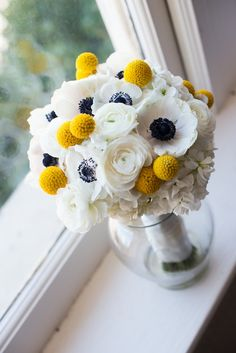 This white anemone bouquet is almost too cute for words! Yellow billy balls are one of our favorite bouquet ingredients and this is no exception! | A Southern Tradition