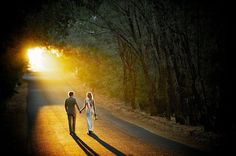 """Why We Love It: We love the symbolism in this gorgeous photo, walking into the sunset to start their new lives together.Why You Love It: """"Life's journey has just started. Beautiful."""" —Tammie S. """"They have a long road ahead of eternal love; very pretty."""" —Rebecca T.Photo Credit: Russell Ord Photography"""