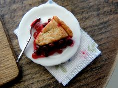 Cherry pie slice. 1:12 scale made with polymer clay by Kim Saulter