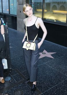 Elle Fanning sports clingy tank top as she steps onto Hollywood Walk Of Fame with gal pal | Daily Mail Online