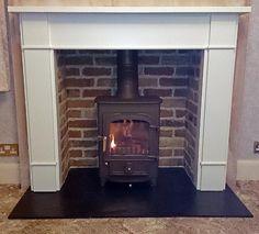 """Honey glow brown Clearview pioneer 400 with MDF mantel, reclaimed brick slip chamber & slate tiled hearth"" Hearth Tiles, Brick Hearth, Slate Hearth, Fireplace Hearth, Stove Fireplace, Fireplace Surrounds, Fireplaces, Fireplace Ideas, Mantle Ideas"