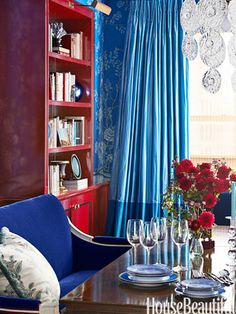Curtains in two tones of Duchesse silk from Zimmer + Rohde play up the blues in the dining room.