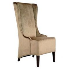 """Upholstered high-back side chair with a wingback silhouette.  Product: Chair     Construction Material: Alder wood, plywood and velvet   Color: Beige and mahogany       Features:   High-back  Wingback silhouette        Dimensions: 46.9"""" H x 27.8"""" W x 21.5"""" D"""