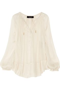 Isabel Marant  Farah draped sateen blouse  645.00    The fluid lines and relaxed fit of Isabel Marant's ecru sateen 'Farah' blouse make it an effortlessly elegant wardrobe staple you'll want to wear again and again. Balance the languid silhouette with skinny jeans and heels for pared-back Parisian chic