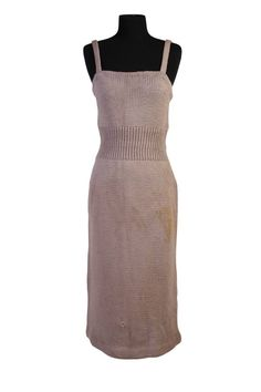 """Grey wool knit dress with spaghetti straps; interior label reads: """"Rudi Gernreich/Designfor/Walter Bass;"""" moth holes evident. PROVENANCE: This piece is identical to the one originally sold in the October 27-28, 1999 Christie's New York auction titled """"The Personal Property of Marilyn Monroe,"""" Sale 9216, Lot 134, Page 108 of that catalogue."""