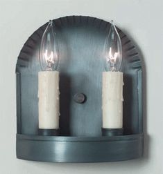 Primitive tin wall sconce