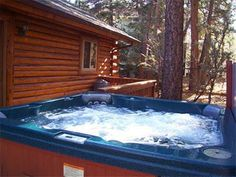 Grey Squirrel Cottage - Three bedroom, two bath, with hot tub, wood fireplace, and WiFi. Deck with charcoal barbecue and fenced yard.