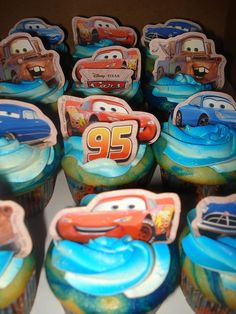 The swirls of blue in the cake & icing - cute idea! #Cars #Disney #cupcakes #birthday #party