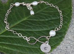 Sterling silver Infinity initial bracelet, Personalized Jewelry and Custom Initial, Mother of the Bride, Best Friends Jewelry by rainbowearring on Etsy https://www.etsy.com/listing/254025737/sterling-silver-infinity-initial