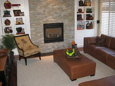 Here is a shot of the whole family room. The chair which used to live up stairs now fits perfectly in this decor! Open Shelving, Shelves, Round Ottoman, Sofa, Couch, Glass Table, End Tables, Love Seat, Blinds
