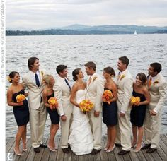 black and white beach wedding | The bridesmaids looked chic and fun in short navy dresses and silver ...