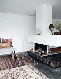 like the rugs and the open fireplace