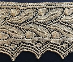 Victorian style knitted lace edging with two rows of acorns ad oak leaves…