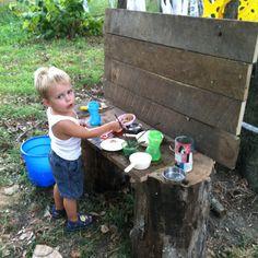 Mud kitchen- a board on 2 stumps