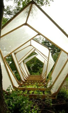 An Unconventional Greenhouse Design - I could make the transparent south-facing walls with some esthetic design.