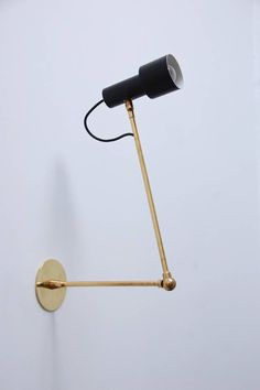 Anonymous; Brass and Enameled Metal Wall Light by Stilnovo, 1950s.