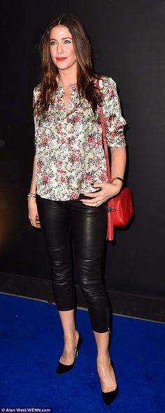 Chic and cheerful: Lisa Snowdon dressed down in a boxy floral top that she teamed with cropped black leather trousers