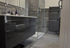 Luxury grey bathroom design with contemporary grey towel rail and high gloss grey cabinetry Contemporary Grey Bathrooms, Grey Bathrooms Designs, Towel Rail, Bathtub, Cool Stuff, Luxury, High Gloss, Bathroom Ideas, House