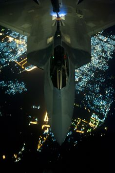 The Aviationist » Super Cool Night Photos of the F-22 Raptor stealth jets refueling mid-air enroute to Syria