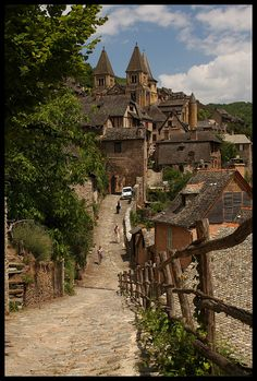 Conques, UNESCO World Heritage Site, Aveyron, France. It is built on a hillside and has classic narrow Medieval streets with remarkably well preserved houses. Places Around The World, The Places Youll Go, Oh The Places You'll Go, Places To Visit, Around The Worlds, Sainte Foy De Conques, Wonderful Places, Beautiful Places, Beaux Villages