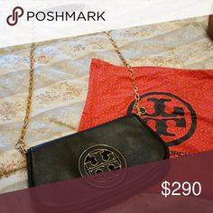 Tory Burch Amanda clutch Authentic black leather clutch used maybe twice. In new condition and comes with dustcover bag. Tory Burch Bags Clutches & Wristlets
