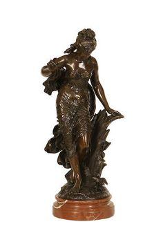 Auguste Louis Mathurin Moreau (French, 1834-1917): A bronze figure of Jeune Femme à l'oiseau