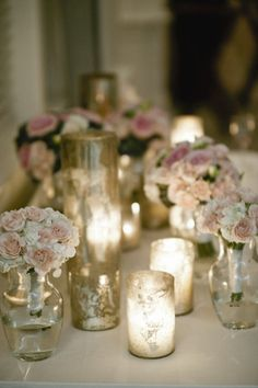 Idea for the head table - bouquets from wedding party in vases as part of table decor