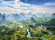 Guilin Guilin, China mountain sky outdoor Nature grass mountainous landforms valley mountain range canyon geographical feature landform atmospheric phenomenon aerial photography hill alps landscape background tourism rural area green plateau bird's eye view grassy lush hillside overlooking surrounded land highland