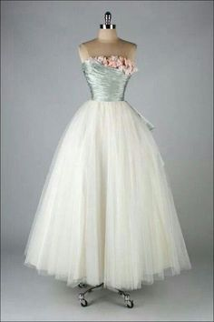 Vintage style dress with blue top with pink flowers and white tulle layered skirt