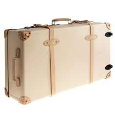 Handcrafted by Globe-Trotter, the British company whose expertly crafted luggage has been carried by royalty