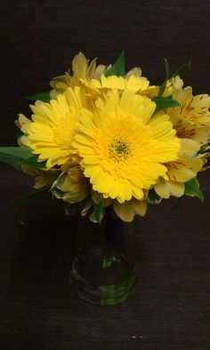 Bridesmaid bouquet of yellow gerbera daisies and alstroemeria