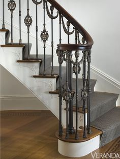 This railing was modeled after one in a historic house in Nashville, but we simplified the design and changed it to include swags, eagles and pineapples. The metalwork by Les Métalliers Champenois is an example of great craftsmanship in bronze.