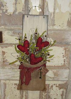Primitive Heart Burlap Wall Board with Florals Source: woodrufflesandlace.com