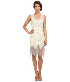 Mr. Fitzgerald himself would approve of this flapper influenced delight. Gatsby will never know what hit him when you hit the dance floor in a dress that is meant to move. Wonderful fringe flirts and glittery sequins sine with each and every movement. Unique Vintage Forster Beaded Flapper Dress Ivory/Silver - 6pm.com