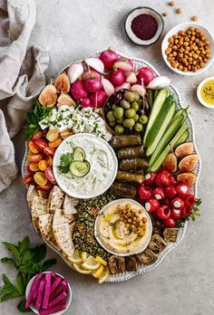 An easy guide on how to make a Mezze Platter with hummus tzatziki tabbouleh pita and so much more! Charcuterie Recipes, Charcuterie And Cheese Board, Cheese Boards, Party Food Platters, Cheese Platters, Veggie Platters, Healthy Snacks, Healthy Eating, Healthy Recipes