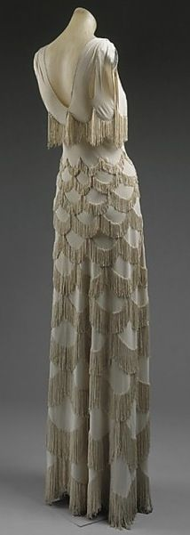 Time frame is pushing it and you can definitely start to see the shift in fashion here, but has the fun tassels that made that era what it was. 1938 Madeleine Vionnet, The Metropolitan Museum of Art