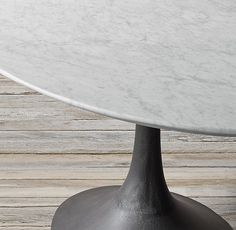 RH's Aero Marble Oval Dining Table:Paying homage to the sweeping lines of midcentury furnishings, our table is a study in simplicity. Defined by its balanced proportions and arching, sculptural curves, our interpretation pairs a cast metal pedestal base with a bullnose marble top.