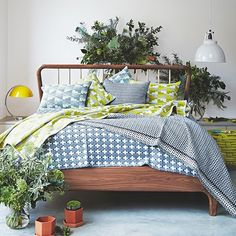 Mid-century bedroom with tons of botanicals for a super-fresh look!