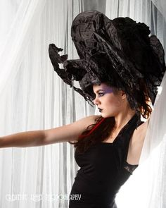 I feel that, when designing a completely black outfit, particular attention must be paid to silhouette and texture. That hat succeeds fantastically at utilizing both!