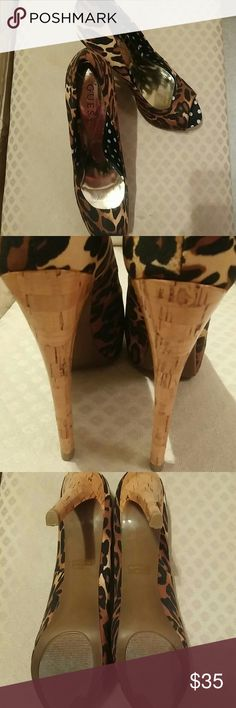 """Guess Cheetah print peep toe platforms Guess LIKE NEW peep-toe platform heels in a cheetah print. Cork 4+ inch heels with a 1 inch platform. Interior of shoes has a metallic lining under the foot area with """"Guess"""" printed on it and side and toe area lined with black & white polka dot satin. Beautiful and very sexy shoes! Size 7M. Guess Shoes Platforms"""