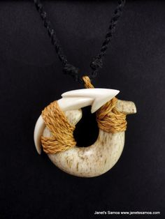 Janet's - Whale Tooth on Bone BRPW24, 245.00 AUD (http://www.janetssamoa.com/whale-tooth-on-bone-brpw24/) Whale Jaw Bone and Whale Ivory Carved into Rounded Fish Hook Samoan Carvings and Motifs. Pendant Held with Afa (Coconut Husk)