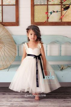 Dreamy #wedding #flower girl dress, featuring satin top bodice with ruffled strap, sheer tulle skirt falls with tea length,  black #ribbon is attached at natural waist.