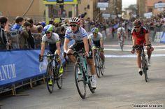 T-A: 2nd Michal KWIATKOWSKI (OMEGA PHARMA - QUICK-STEP), 3rd Simon CLARKE (ORICA GreenEDGE) and slipping to 4th Philippe GILBERT (BMC RACING)