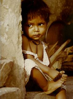 Child of Poverty is not the proper way to say, maybe is more privileged then we imagine,  go here for more, http://500px.com/NinaohmanOjeda