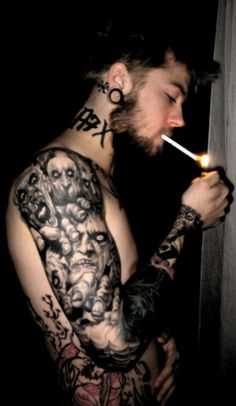 This is an awesome realistic horror tattoo sleeve. Lots of black, but just the right amount before it's too much.-BirdY